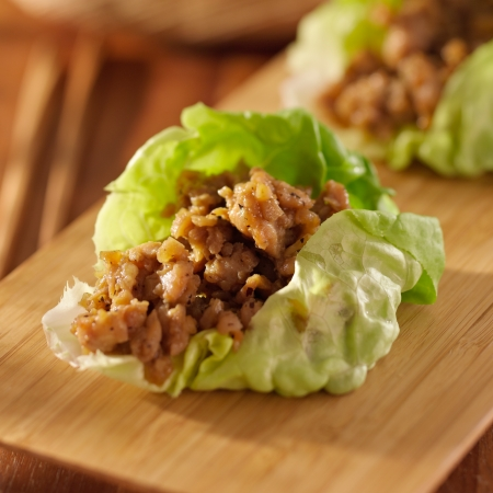 international food: Asian lettuce wrap with minced chicken and seasonings