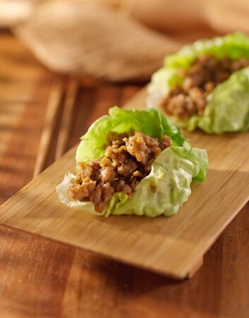 Asian lettuce wrap with minced chicken and seasonings photo