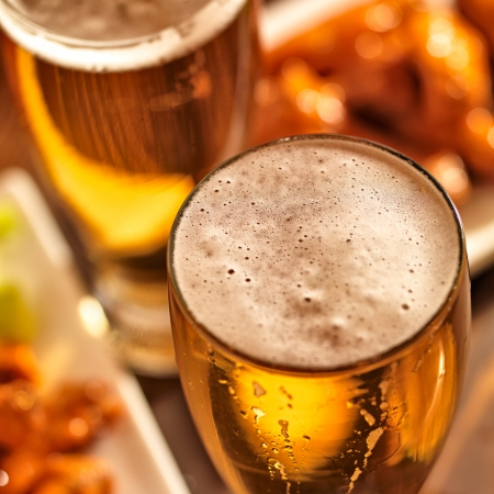 beer drinking: beer and wings at celebration