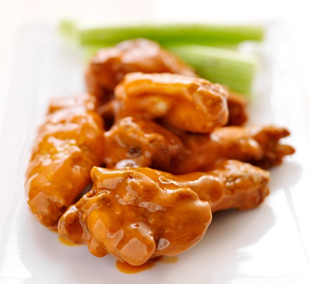 hot wings: plate of buffalo wings with celery.