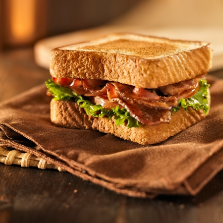 sandwich: BLT bacon lettuce tomato sandwich on a napkin