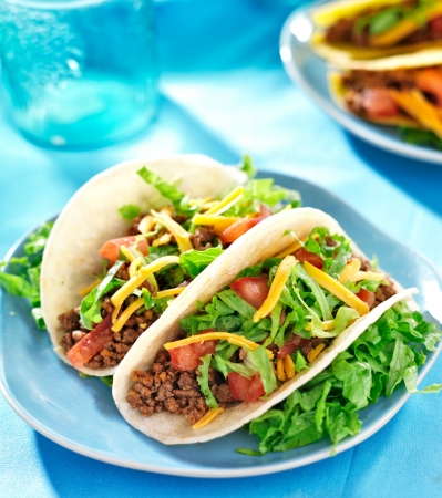flour: Mexican food - Soft shell tacos with beef, cheese, lettuce and tomatoes