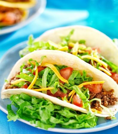taco tortilla: Mexican food - Soft shell tacos with beef, cheese, lettuce and tomatoes