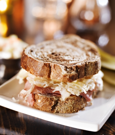 kosher: reuben sandwich with kosher dill pickle and coleslaw