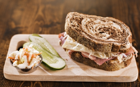 reuben sandwich with kosher dill pickle and coleslaw photo