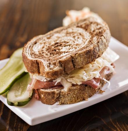 reuben: reuben sandwich with kosher dill pickle and coleslaw