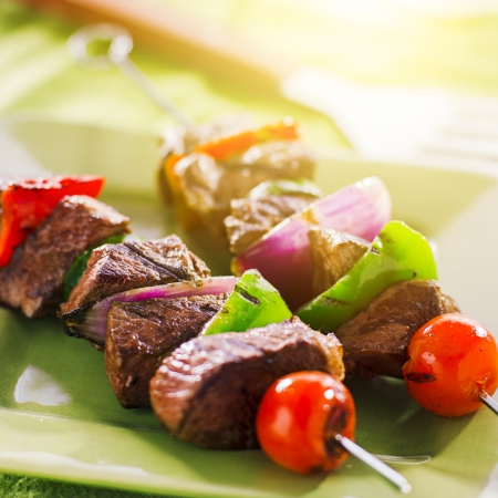 grilled beef shishkabobs on green plate photo