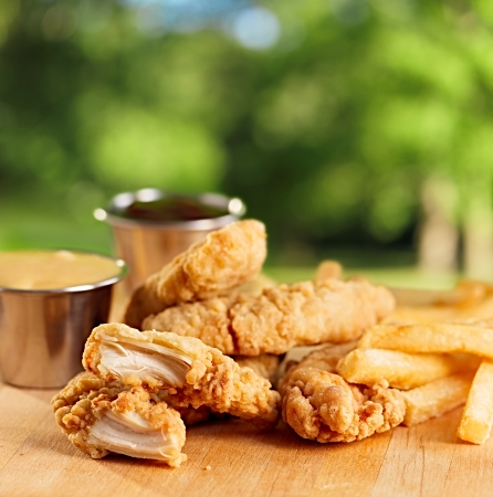 deep fry: fried chicken strips with french fries and sauce