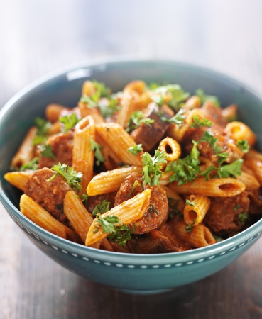 bowl of rigatoni pasta with sausage photo