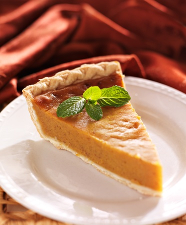 pumpkin pie with mint garnish photo