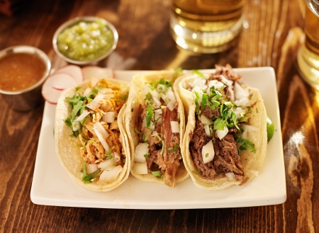 spicy chicken: authentic mexican barbacoa, carnitas and chicken tacos