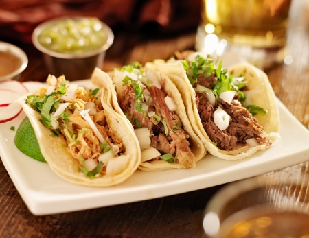 authentic mexican barbacoa, carnitas and chicken tacos photo