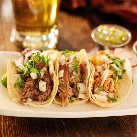 street food: authentic mexican barbacoa, carnitas and chicken tacos