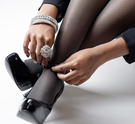 women with jewelry putting on shoes Stock Photo - 21921897