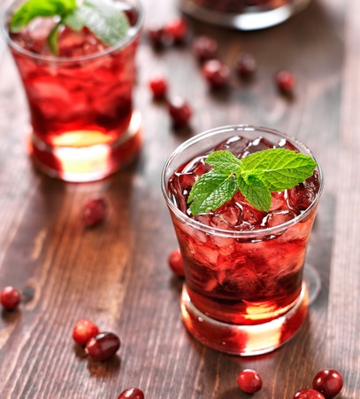garnish: cranberry cocktail with mint garnish.