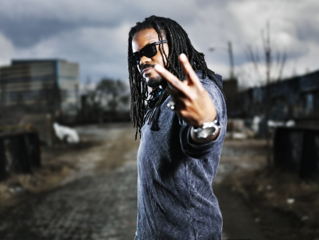 urban african man showing peace sign  Stock Photo