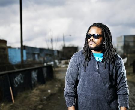 swag: african man in urban portrait.