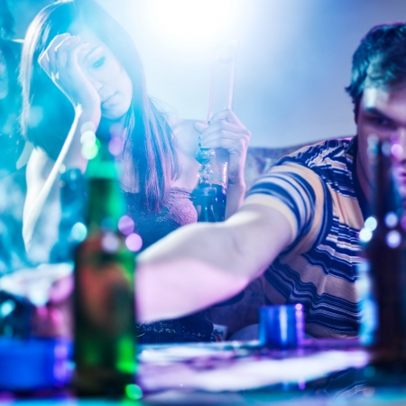 drunk girl: drug abuse at house party with smoke