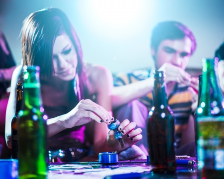 substance: drug using teens at house party  Stock Photo