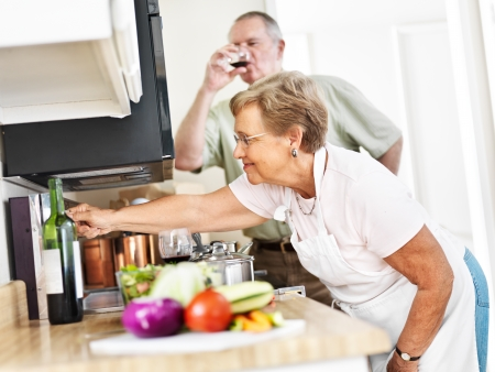 seniors cooking in kitchen at home Stock Photo - 22851711