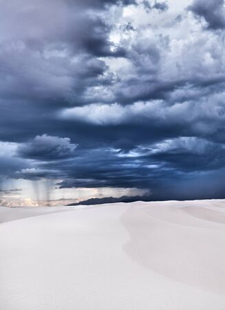 white sands in new mexico with stormy sky photo