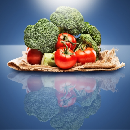 healthy produce on blue background with light above  Banco de Imagens