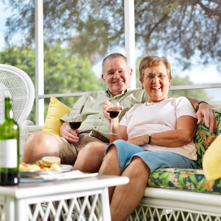 senior couple outside on patio looking at camera Stock Photo - 22995014