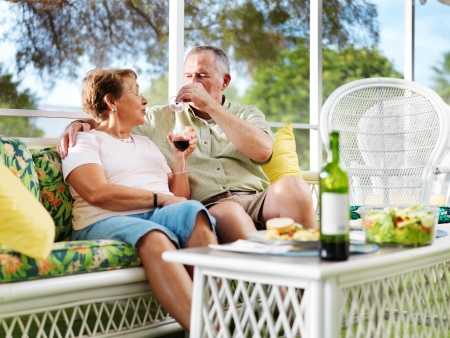 senior couple outside on patio relaxing photo
