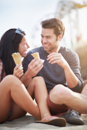 happy couple with ice cream near santa monica pier photo