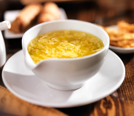 drop out: chinese food - bowl of egg drop soup Stock Photo