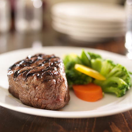 grilled steak on plate with vegetables Stock Photo - 23329406