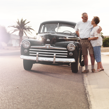 senior couple with vintage car photo
