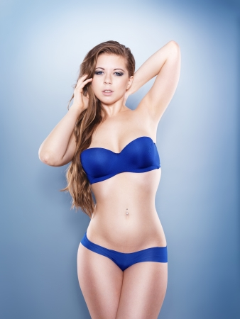 sexy big breasted model on blue background photo