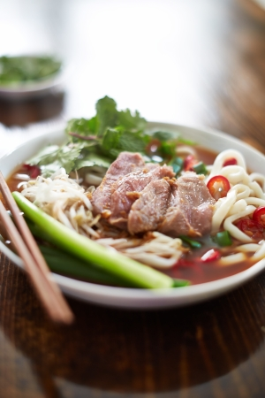 close up food: bowl of vietnamese pho in natural light