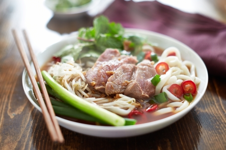 steaming hot bowl of pho with rare beef Stock Photo