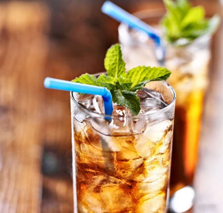 chilled: iced tea with blue straw and mint garnish Stock Photo