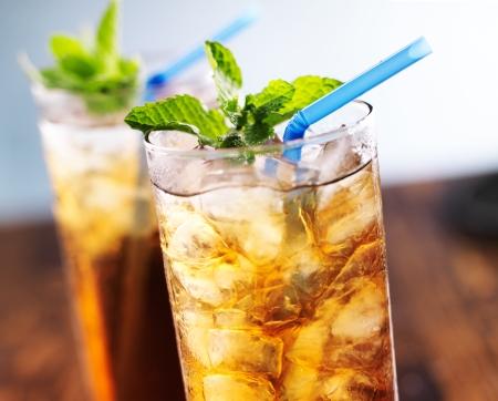 iced tea: iced tea with blue straw and mint garnish Stock Photo