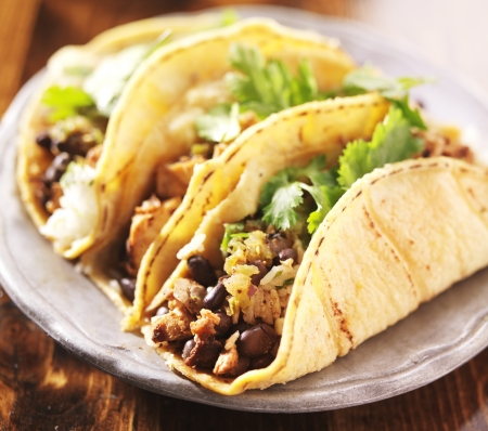 rustic food: Tacos - in mexican yellow corn tortilla with chicken