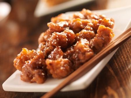 chinese sesame chicken with chopsticks Reklamní fotografie