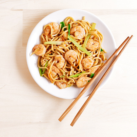 international food: chinese shrimp lo mein overhead shot