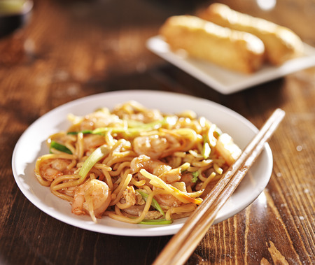 lo mein: chinese shrimp lo mein with chopsticks
