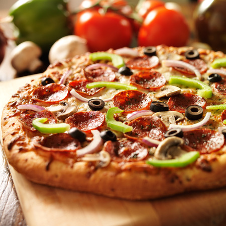 american cuisine: supreme italian pizza with pepperoni and toppings
