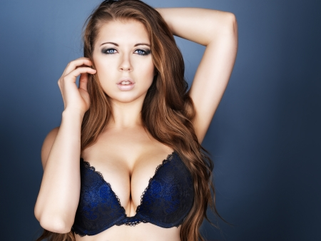sexy girl in bra and long hair on dark blue background photo