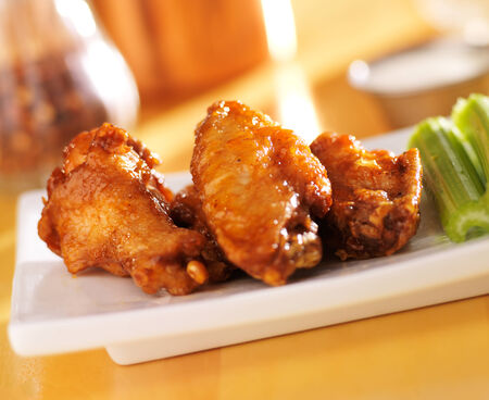 bbq buffalo chicken wings with ranch dip and celery photo