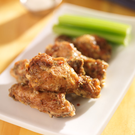 zesty garlic parmesan chicken wings Stock Photo