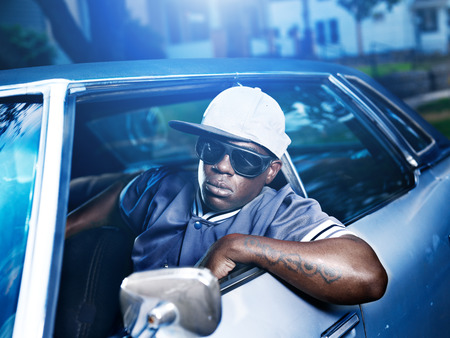 hip hop: cool african man in old car Stock Photo