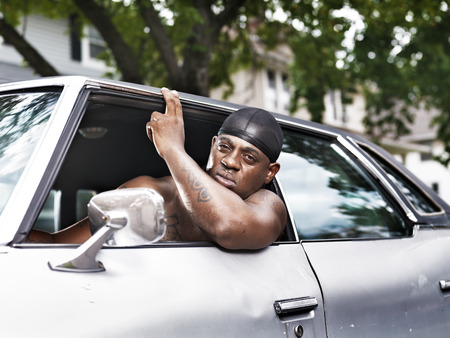 rough african american in old car shirtless photo