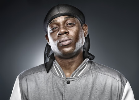 african rapper on grey background with bold lighting photo