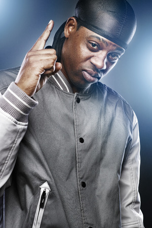 hip hop man: young black man in studio making hand sign Stock Photo