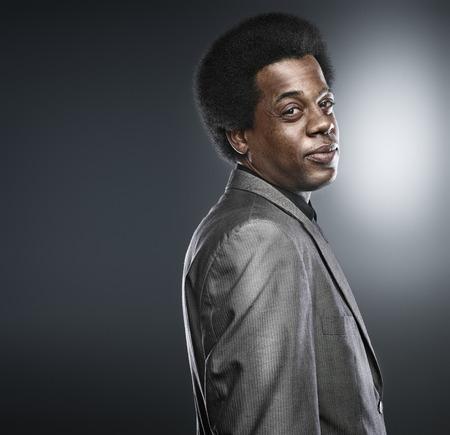 african man in suit shot in studio photo